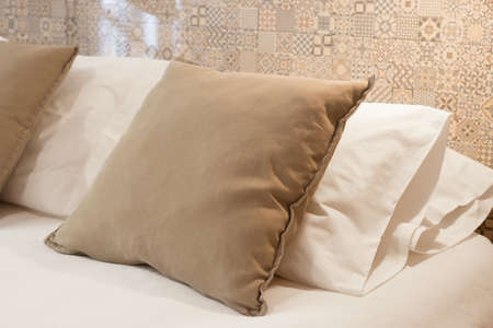 Fresh and clean pillows on a bed
