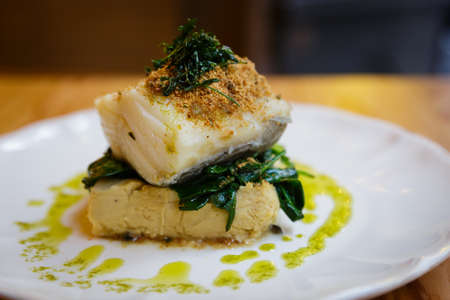 Gourmet Baked Codfish Set On a White Plate Stock Photo