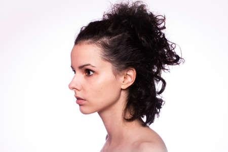 curly girl, closeup profile portrait, light background