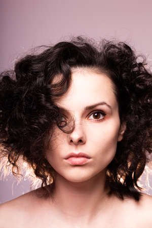 beautiful curly woman, gray background
