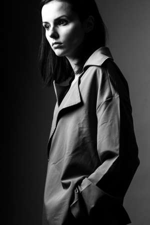beautiful young girl in a trench coat Stock fotó