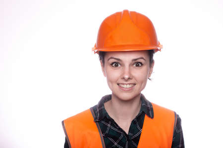 woman builder in an orange helmet, hardware store Standard-Bild