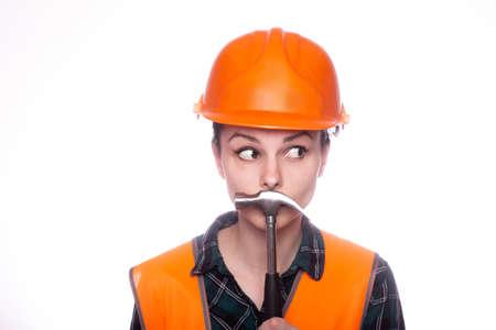 female plumber in an orange helmet, hardware store