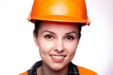 beautiful woman in construction uniform, close-up portrait on a white background