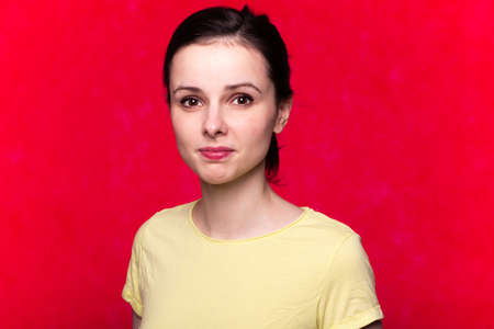 woman in a t-shirt on a red background