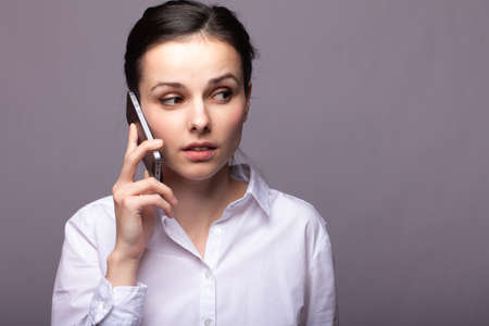 dispatcher in a white shirt speaks on the phone, call center operator