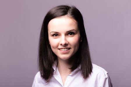 beautiful woman manager, office style, gray studio background Reklamní fotografie