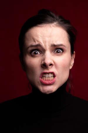 woman in black looks menacing, closeup portrait Stock Photo