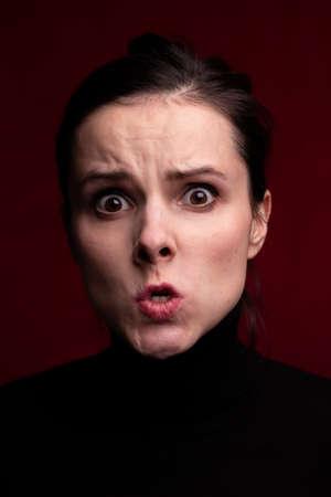 woman in black looks menacing, closeup portrait