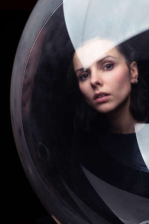 portrait of a woman through the ball, black background