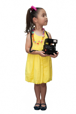 Vintage little photographer in yellow dress Stock Photo