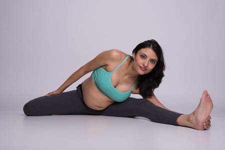 Healthy pregnant lady stretching