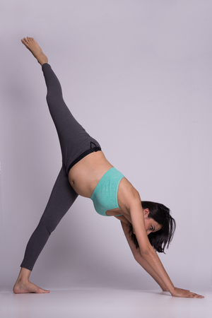 Healthy pregnant lady doing Yoga Stock Photo