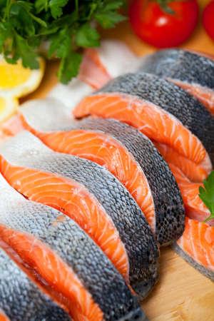 raw salmon on cutting board photo