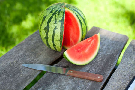 water melon on wooden table photo