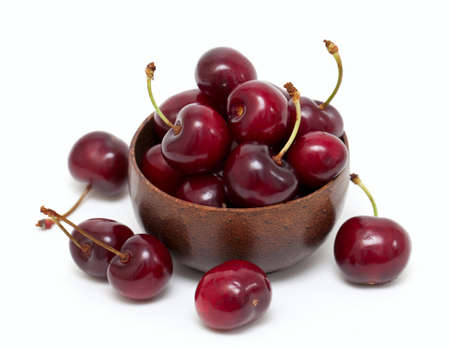 cherry in a bowl isolated on white Stock Photo - 13856011