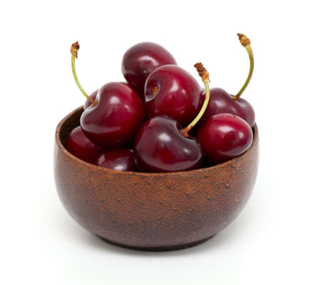 cherry in a bowl isolated on white photo