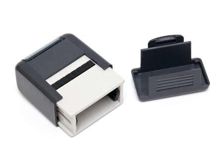 sigil: plastic stamp isolated on white background