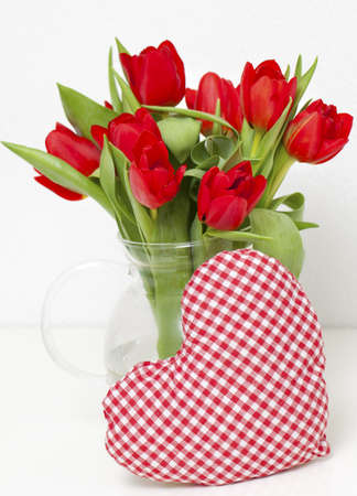 red tulips and heart-shaped pillow photo