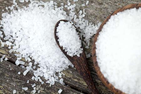 sea salt on wooden table photo