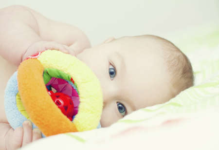 portrait of playing baby with smiling eyes photo