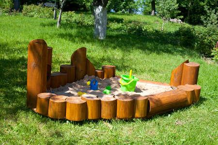 children sand box in the garden Stock Photo - 13867422