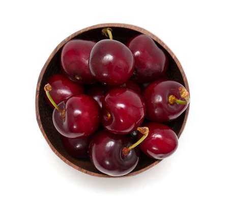 cherry in a bowl isolated on white, top view photo