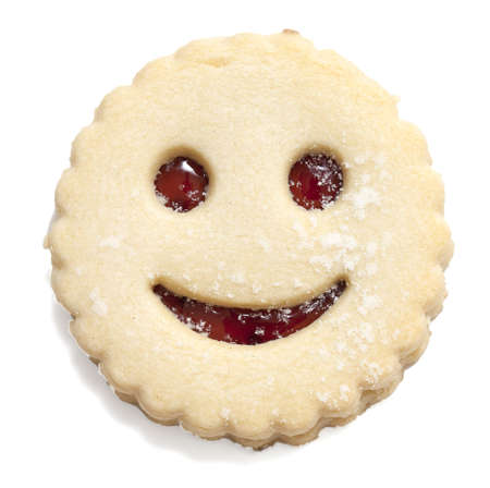 smiling cookie isolated on white photo