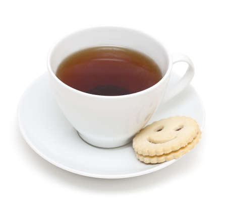 cup of tea and smiling cookie isolated on white photo