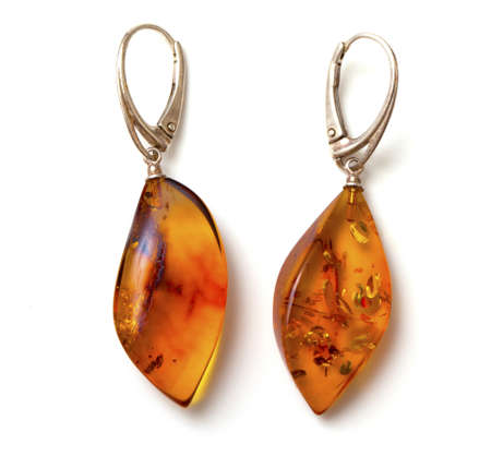 amber earings on white background Stock Photo