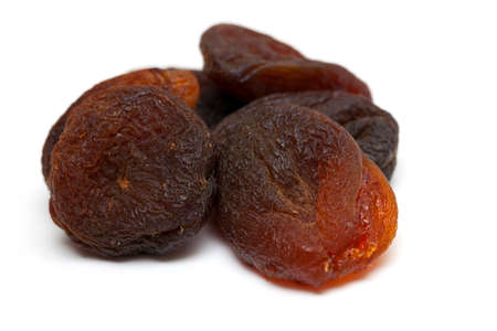 apricots: sun dried apricots isolated on white