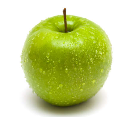 green apple with water drops close up on white background photo