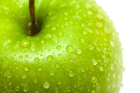 green apple with water drops close up photo