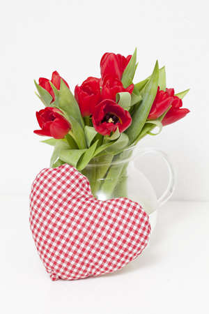 tulips and heart-shaped pillow photo
