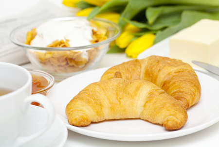 Continental breakfast and flowers Stock Photo - 13871595