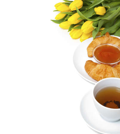 Continental breakfast and flowers, empty space for your text photo