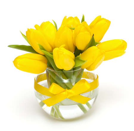 yellow tulips in a vase tied with a yellow ribbon photo