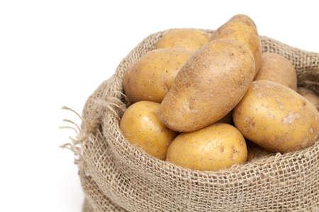 potatoes in a burlap bag  photo
