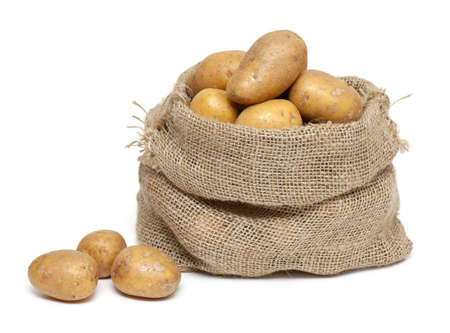 potatoes in burlap bag isolated on white background photo