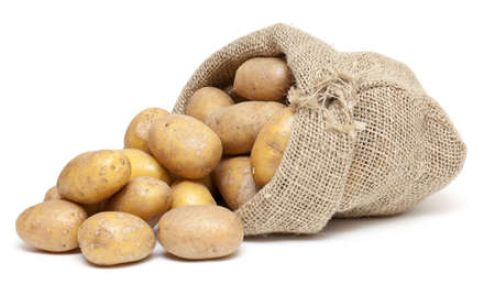 potatoes in a burlap bag isolated on white background photo