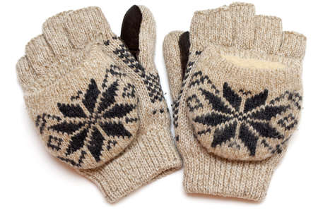 pair of warm knitted gloves isolated on white photo