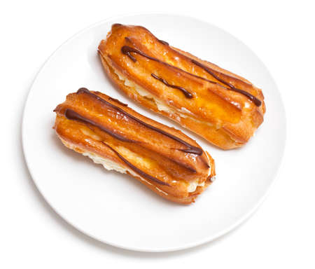 two eclairs on a white plate isolated