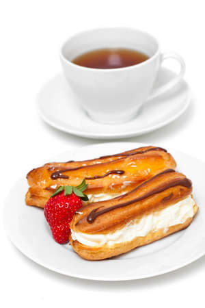 fresh cream puff with whipped cream and strawberry and cup of tea  photo