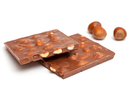 milk chocolate with hazelnuts isolated on white photo