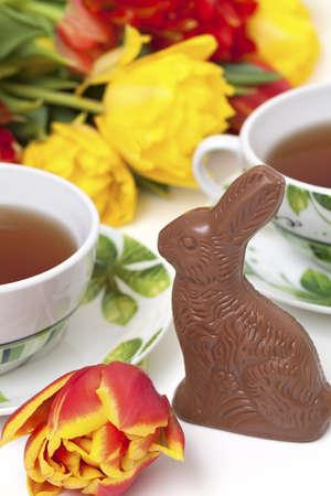 Easter chocolate bunny, tulips and tea photo