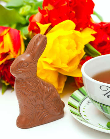 Easter chocolate bunny, tulips and tea photo