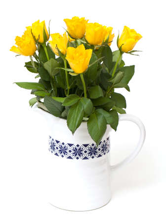 yellow roses in a vase isolated on white photo