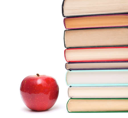 apple and stack of books isolated on white photo