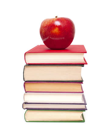 teaching material: apple on stack of books isolated on white Stock Photo