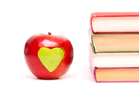 apple with green heart and stack of books photo